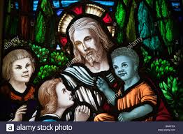 detail of jesus and multi ethnic children from a stained glass