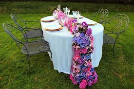 wedding flowers exeter floral table runner made with hydrangeas and roses by carole