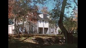 a beautiful georgian colonial house surrounded by trees and an
