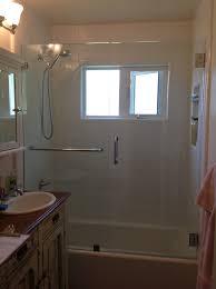 bathroom corner shower enclosure with steel door handle and cream