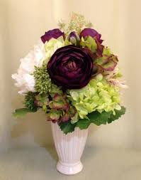dahlia peony ranunculus and hydrangea arrangement in cream
