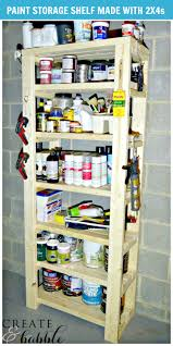 paint storage shelf made with 2x4s create and babble