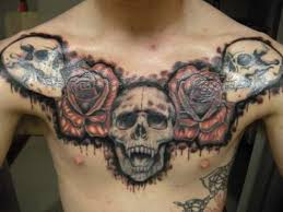 skulls with roses tattoo on man chest