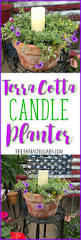 beautify your backyard decor with this pretty terra cotta candle