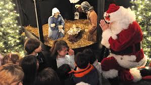 santa kneeling at the manger a kneeling santa claus one powerful image
