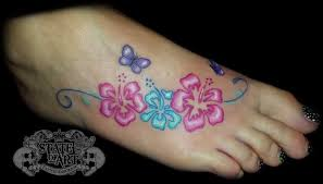 colored hibiscus tattoos on by state of