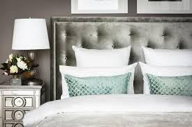 gray bedroom with mirrored nightstand transitional bedroom