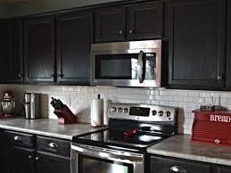 backsplash tiles for dark cabinets dark cabinets white subway tile backsplash tatertalltails designs
