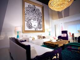 amazing living room with chandelier and framed wall art also bold