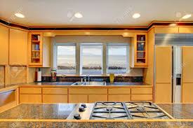 large luxury modern wood kitchen with granite counter tops and