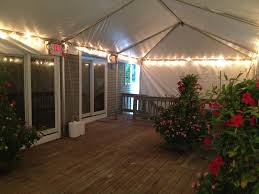 15 x 25 frame tent installed on deck with string lighting
