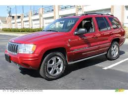 red jeep cherokee 2004 jeep grand cherokee overland 4x4 in inferno red pearl