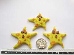 yellow color cute handmade starfish polymer clay fridge magnet in yellow color