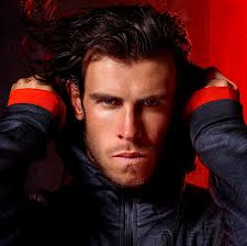 bale needs a hair cut real madrid attacker gareth bale wraps up warm for adidas