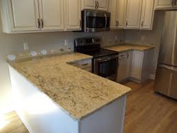 Paint Laminate Floor White Tile Backsplash Connected By Cream Granite Countertops And