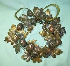 petites choses fall leaves walnuts brass metal wreath