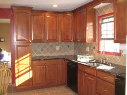 Kitchen Backsplash Ideas With Oak Cabinets Decorating Oak Cabinets By Lowes Kitchens With Wicker Stool And