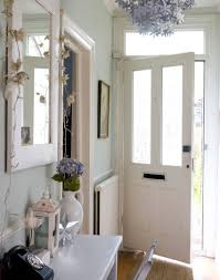 hall furniture ideas pale green hallway with silver floral chandelier maximise your small