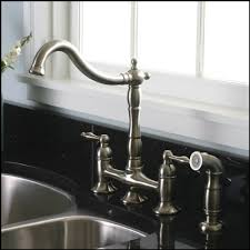 kitchen faucets brushed nickel brushed nickel kitchen faucet with matching sprayer bridge style