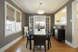Modern Dining Room With Laminate Floors  Flush Light In Evanston - Dining room with french doors