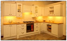 Distressed Painted Kitchen Cabinets by Bathroom Kitchen Cream Cabinets Agreeable Backsplash For Cream