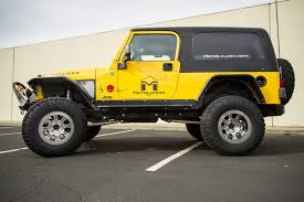 yellow jeep fully cloak u0027d 2006 jeep wrangler lj rubicon