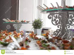 waitress serves tables for cocktail party catering stock photo