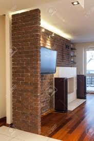spacious apartment stone wall inside of living room stock photo