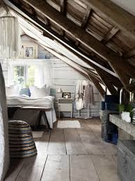 bedroom attic remodel ideas with wooden slanted ceiling attic