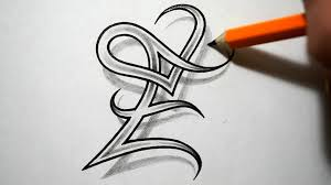 initial e with a heart tattoo design by jsharts on deviantart