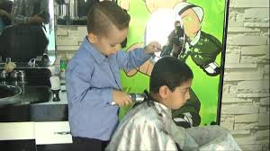 four year old barber gives haircuts in turkey