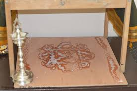 varalakshmi vratham navrathri kalasam jodanai decoration and we make a setup of mandapam small temple like decoration i used my coffee table and placed a plain wooden plank for doing kolams and used my kid s old