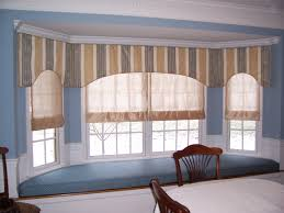 continuous flat valance along large bay window with sheer roman
