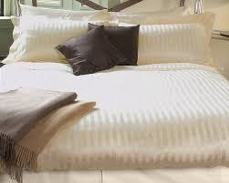 classic stripe luxury bed linens in the linen cupboard