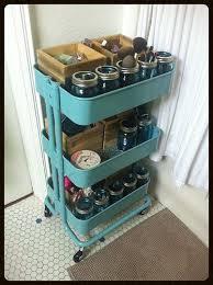 hair and makeup storage ikea råskog cart with blue jars for hair makeup