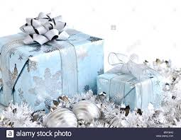 wrapped gift boxes with silver christmas ornaments on white stock