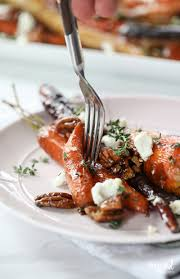 carrot side dish for thanksgiving roasted carrots with candied pecans and goat cheese inspired by