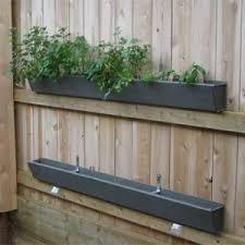 How To Build A Vertical Garden - diy rain gutter garden