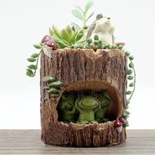 tree stump planters 7 different animal shaped succulent planters just in time for spring