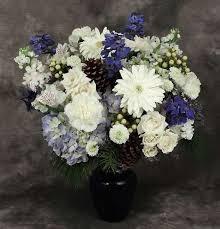 white flower arrangements winter bright vase kremp