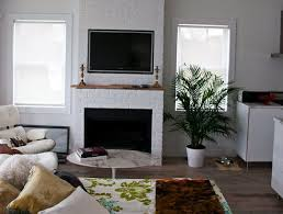 television over fireplace is it safe to mount your tv over the fireplace apartment therapy