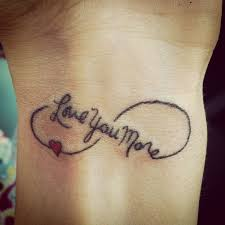 i love you symbol tattoo on wrist