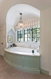 traditional master bathroom with pendant light by bennett frank