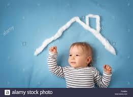 little boy with shape of house stock photo royalty free image