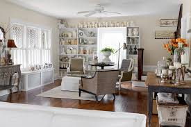 Shabby Chic Pottery by Displaying Pottery Family Room Shabby Chic Style With Armchairs