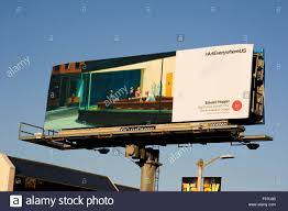 an edward hopper fine art painting is reproduced on a billboard in
