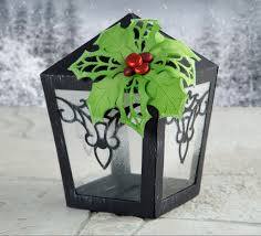 festive papercraft lamp made using the cutting craftorium