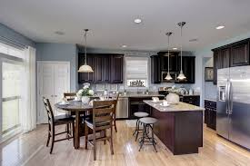 cute dining area right off the kitchen with natural lighting blue