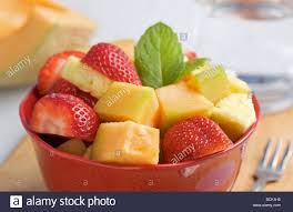 bowl of cut up cantaloupe strawberry and pineapple fruit salad