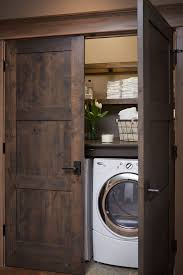 washer and dryer hidden in closet with beautiful dark wooden doors